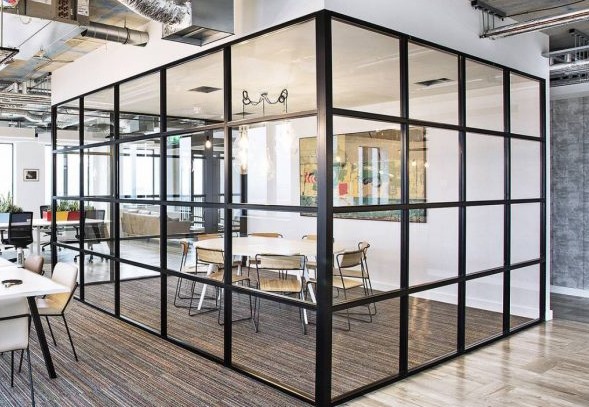 Image features a meeting room with Crittall walls.