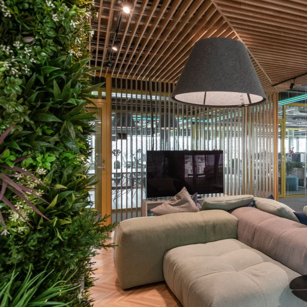 Image features living wall and wooden slat partition.